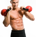 Man performing interval training with kettlebells