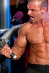 Bodybuilder training his biceps