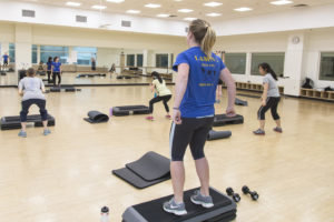 Fitness group working out using interval training