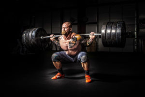 Man squatting massive amount of weight